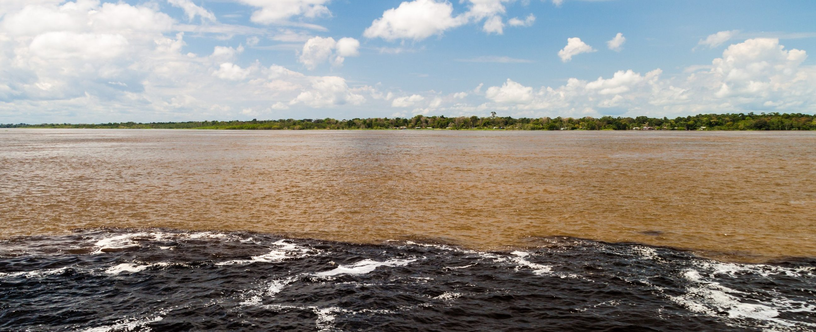 The mythical encounter of the waters, where the Solimoes and Rio Negro meet, but never mix.