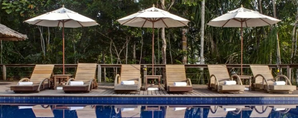 Sunbeds at the edge of the poolat Anavilhanas jungle lodge.