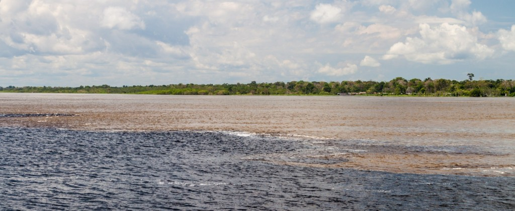 """The """"encounter of the waters"""" where the Solimoes meets the Rio Negro."""