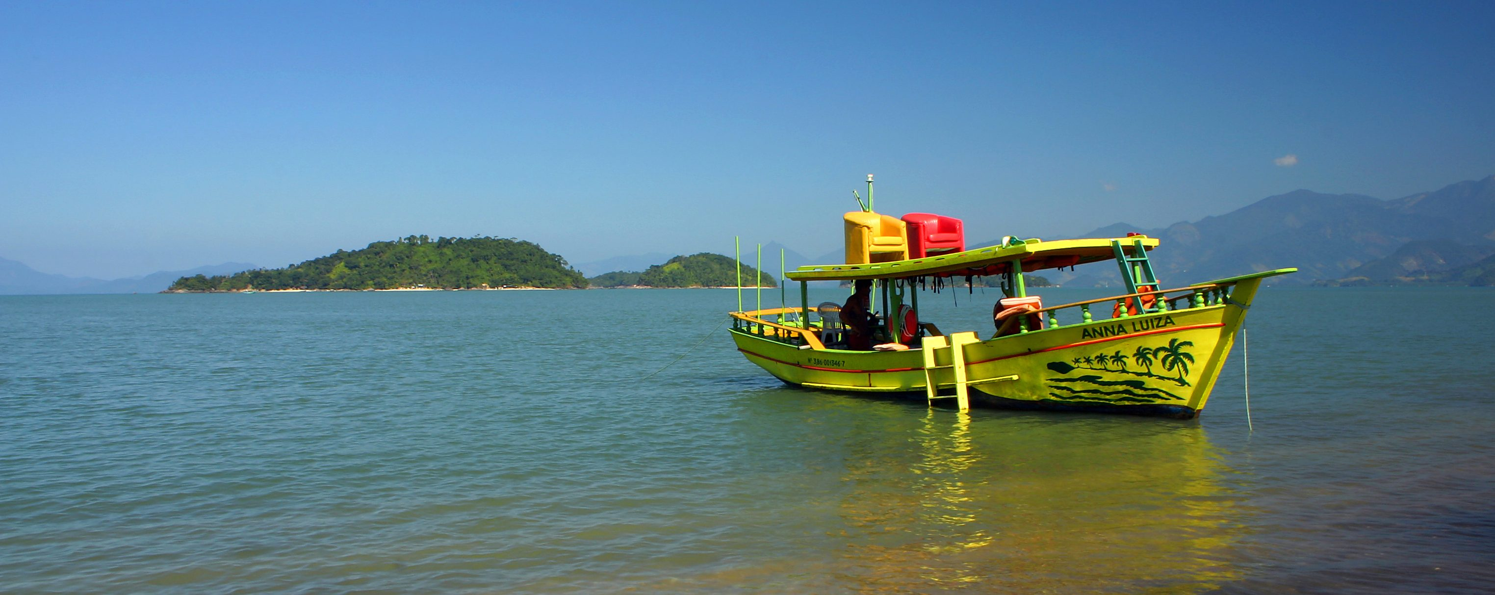 Ilha Grande, one of the boats docked up on the beach.