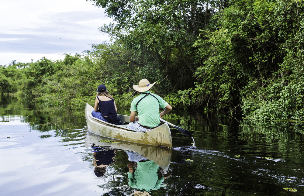Canoeing along the river, one of the activities available on your stay at the Juma lodge.