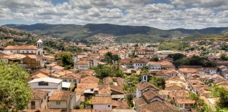 Aerial view of Ouro Preto with mountains in the background.