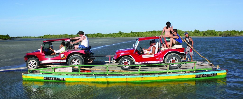 A ferry brings two buggies accross one of the rivers of the Nordeste.