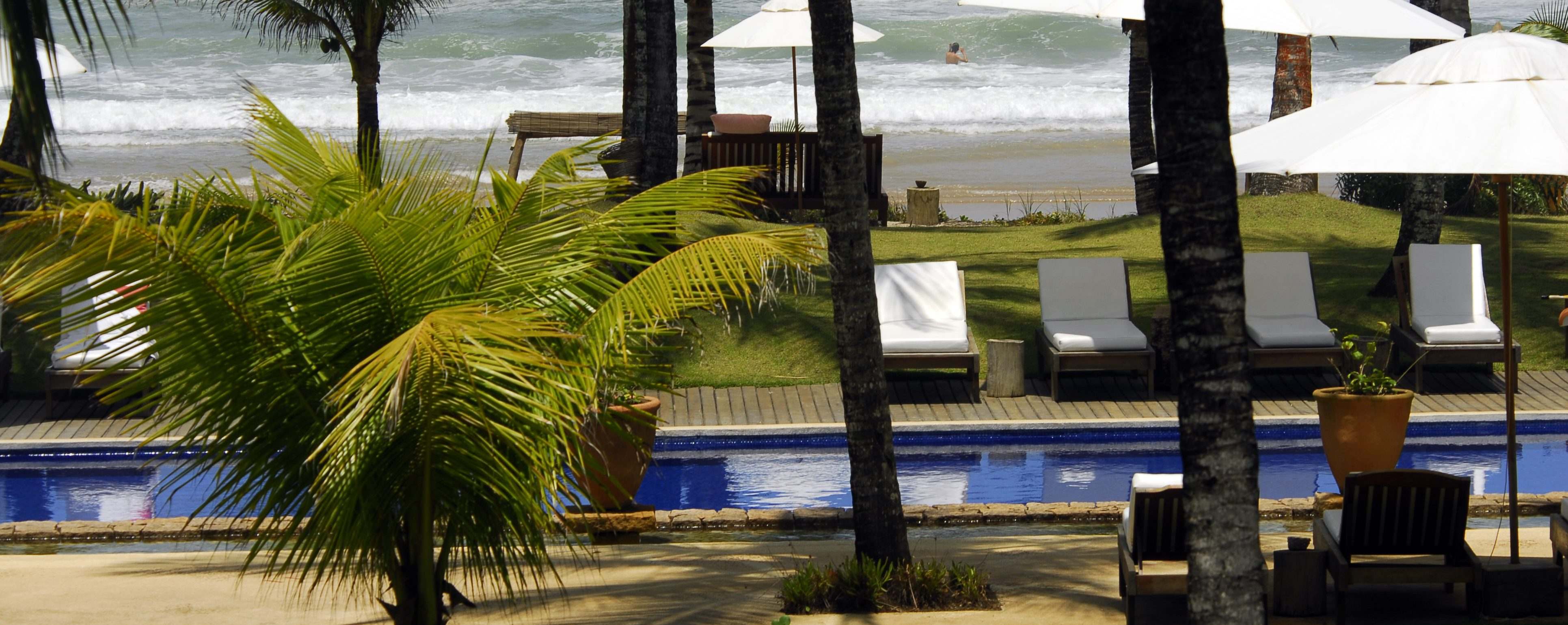 View of the beach from the pool at Txai resort Itacaré.