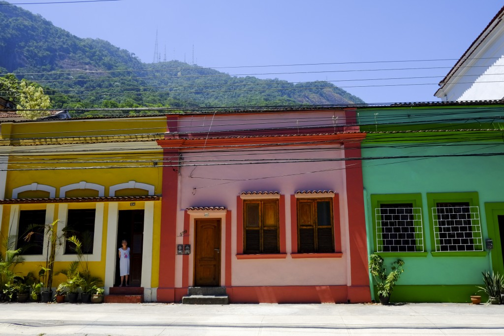 A colourful street in Rio de Janeiro with Tijuca forest in the background.