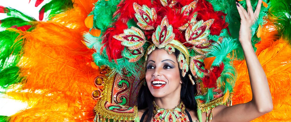 Carnival dancer with colourful headwear.