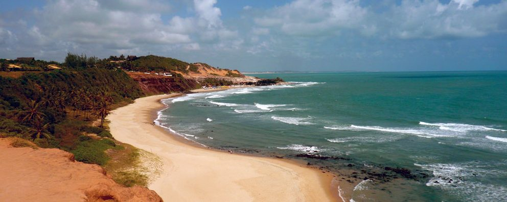 Pipa - the beautiful beach with the waves lapping the shore.