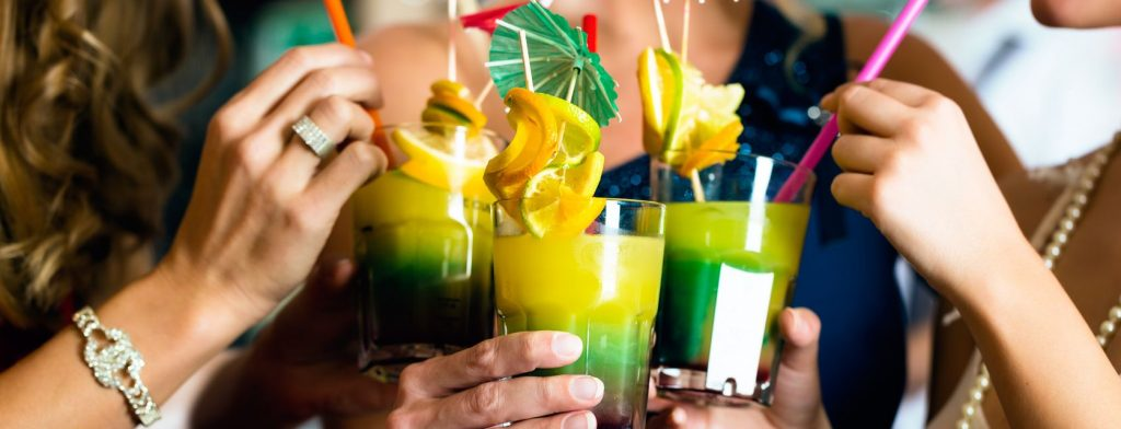 Several friends sip on colorful cocktails in Pipa.