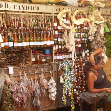 Woman sits at her stall at the ver o peso market in Belem.