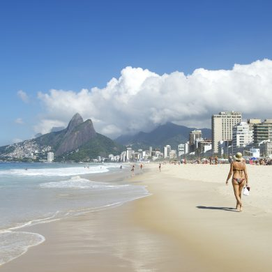 Girl walking on the beach in Rio.