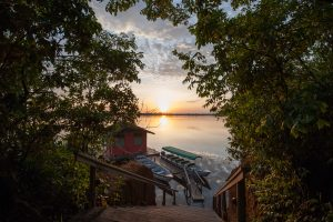 The sun setting over the Amazon river dock of the Anavilhanas lodge.