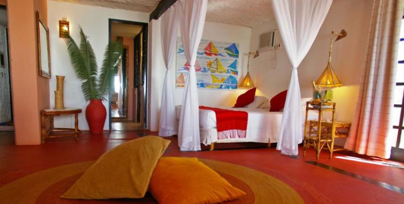A vibrantly coloured room in the pousada porto da lua in praia do forte.