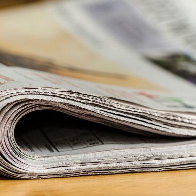 Close up shot of folded over newspaper.