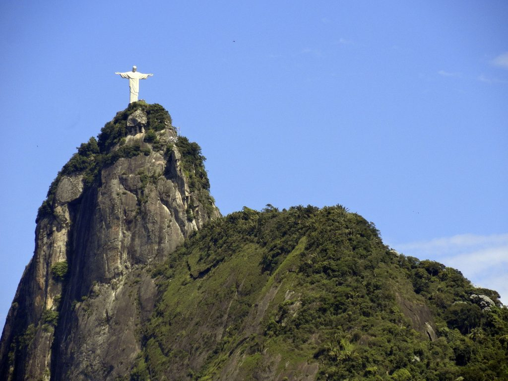 View of Christ the redeemer statue atop corcovado mountain in Rio de Janeiro.