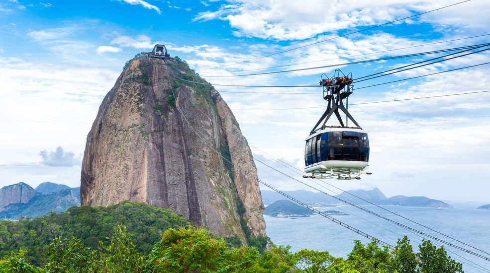Cable car heading up to sugar loaf mountain in Rio de Janeiro.