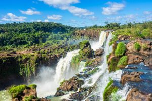 A long - distance shot of the rocky waterfalls at Iguassu.
