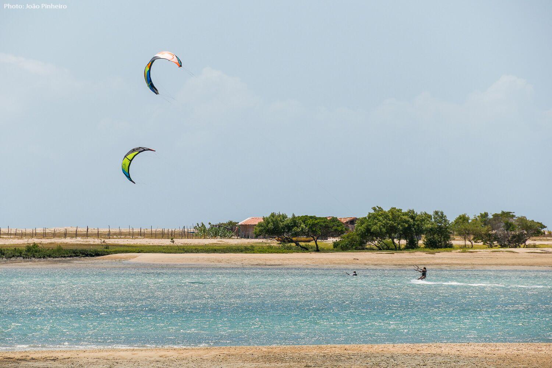 Kitesurfing across a abeautiful lagoon.