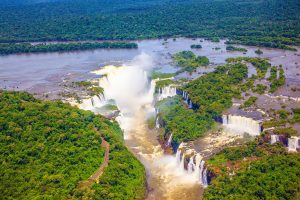Helicopter view of the brown murky waters of Iguaçu.