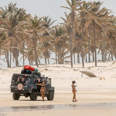 Kitesurfers load up their jeep on the beach in Brazil.