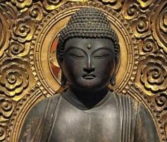 Headshot of buddha statue.
