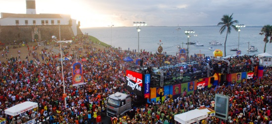 A trio electrico moves through crowd at carnival in Salvador