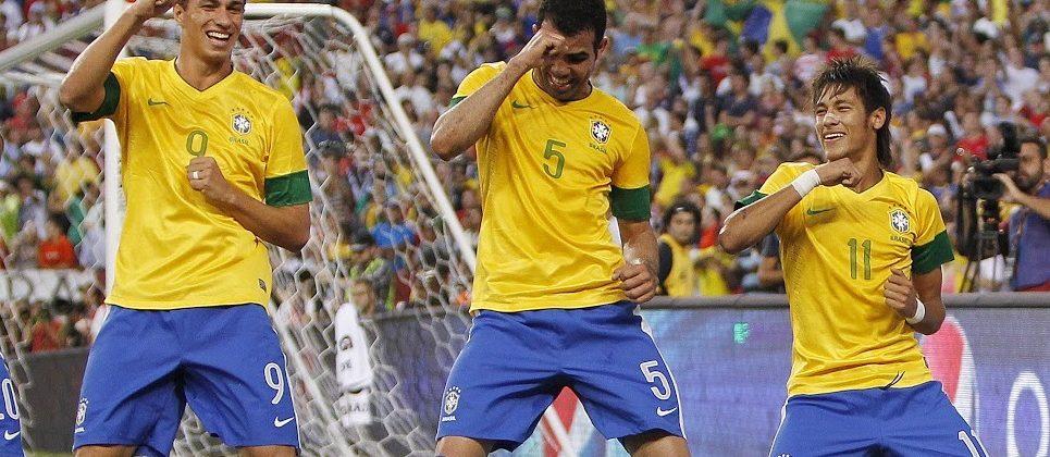 Brazilian footballers dance.
