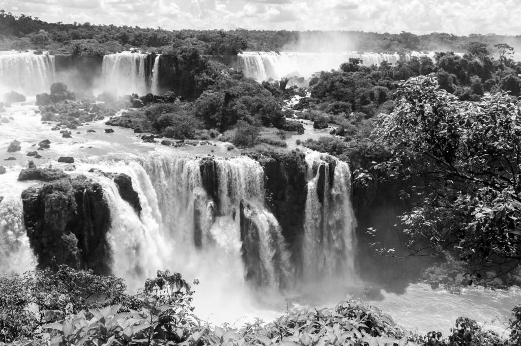 Water gushes down over the greenery at Iguaçu Falls.
