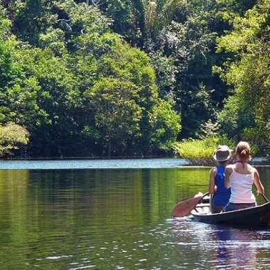 A couple row on an Amazonian River in Brazil.