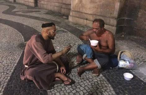Catholic monk from a religious order, eating with poor in Brazil.
